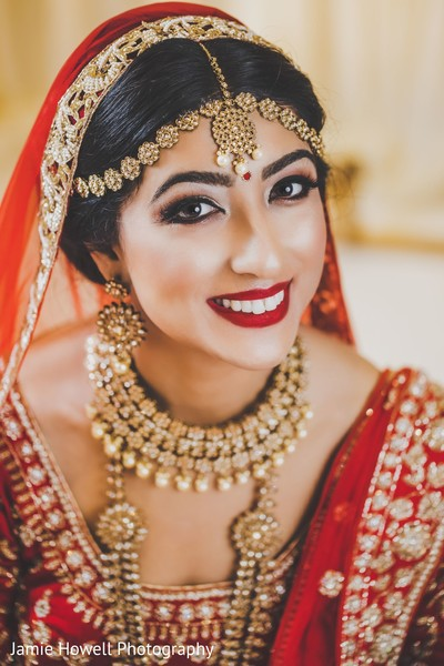 Indian bride in red smiling for the camera
