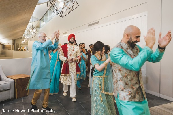 The Indian groom's entourage making their entrance to the venue