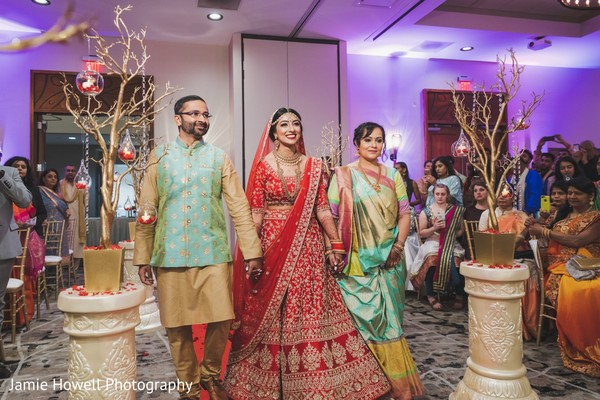 Maharani walking down the aisle escorted by her Indian relatives