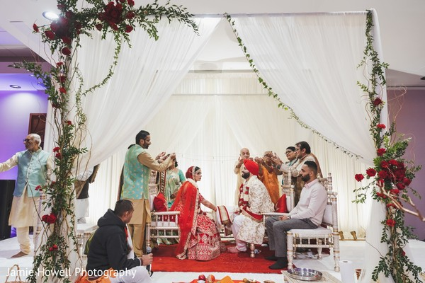 Indian relatives putting cords on the Indian couple