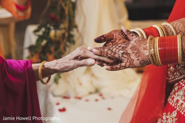 Maharani holding a senior Indian relative's hand
