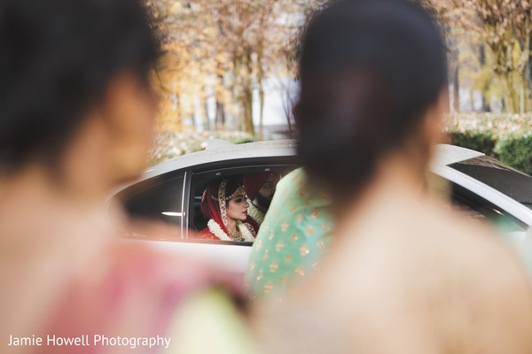 Indian couple leaving the venue in a luxury car