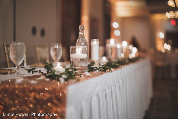 A close up to one of the decorated tables at the reception hall