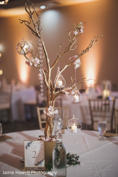 The tree themed decoration at the center of the table