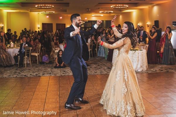 Indian newlyweds enjoying themselves on the dance-floor
