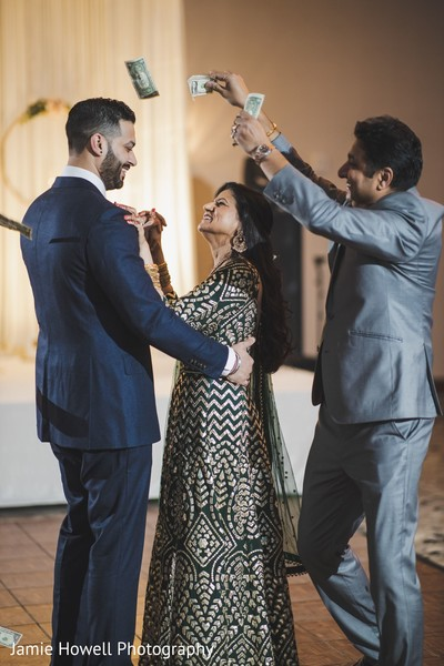 Indian groom dancing with an Indian relative