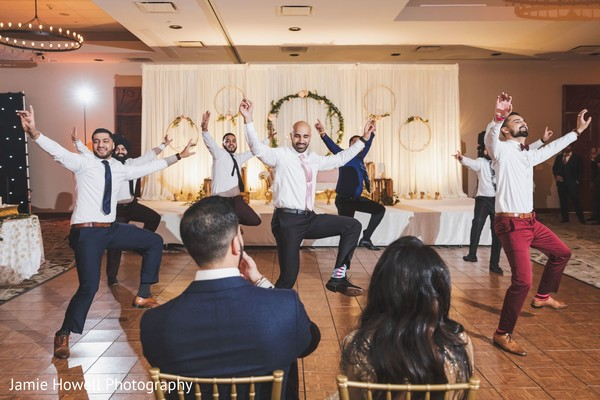 Indian groomsmen performing a choreography