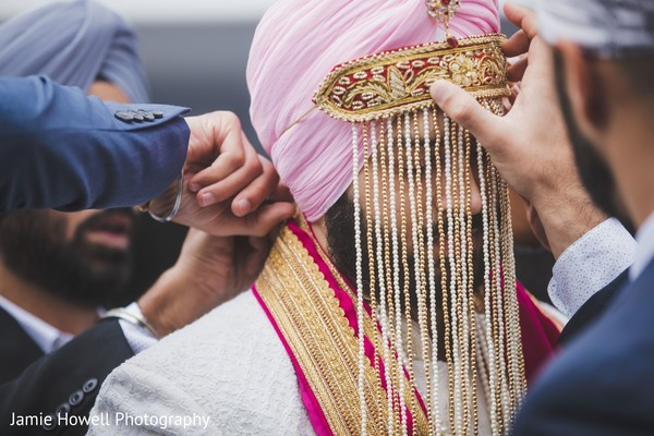 Indian relatives putting the sehra on the Indian groom