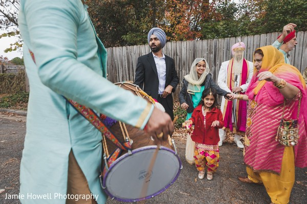 A close up to the drummer during the Baraat