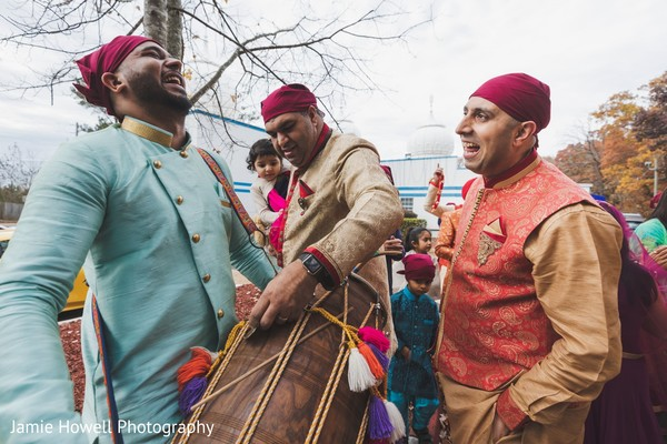 Indian drummer and Indian relatives during the Baraat