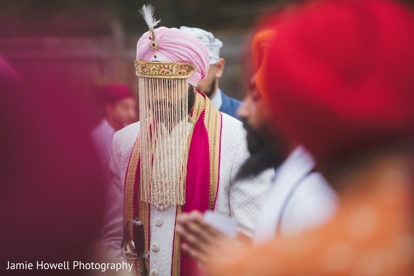 A close up to the Indian groom outside the temple