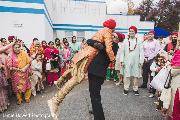 Indian relatives hugging and welcoming each other