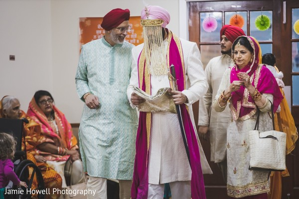 Indian groom and Indian relatives walking down the aisle