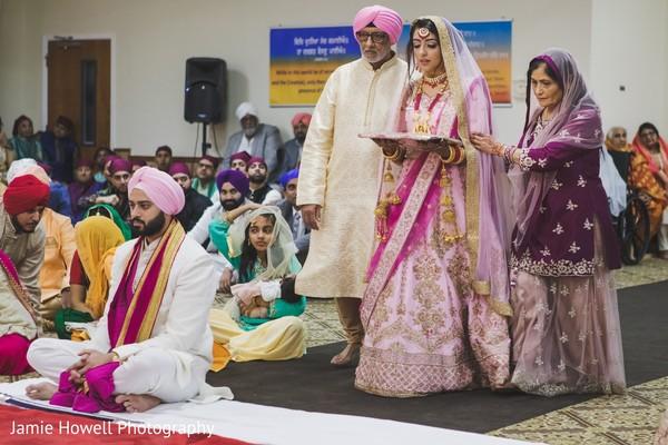 Maharani and Indian relatives walking towards the waiting Indian groom