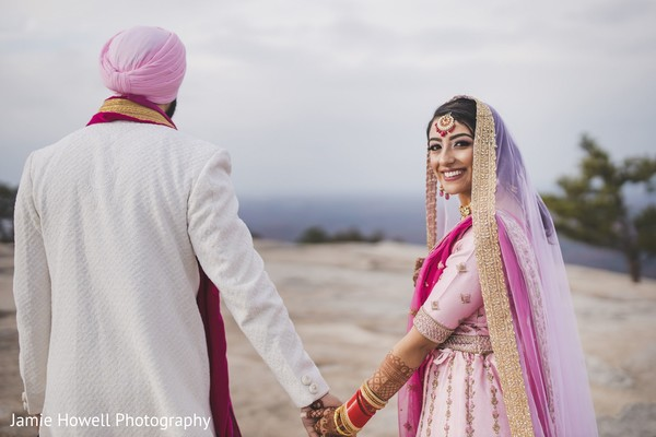 Indian bride holding her Indian groom's hand