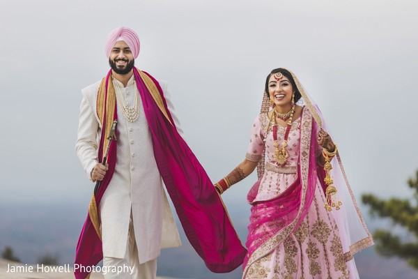 Indian couple holding hands and running