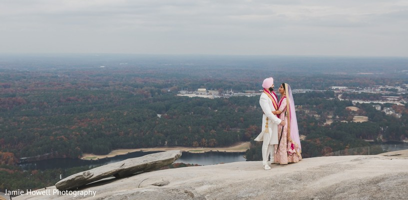 Indian couple sharing a moment atop of a cliff