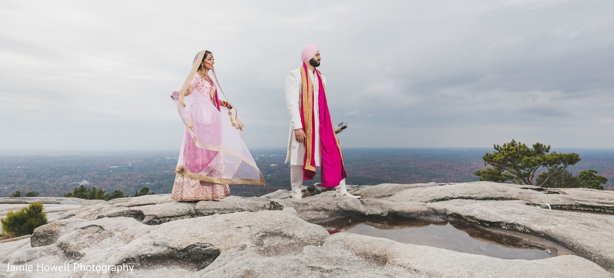 Indian couple walking on the edge of a cliff