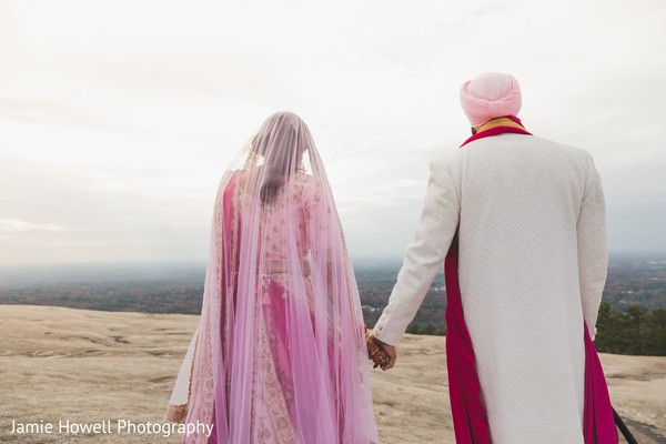 Indian couple walking together to the edge of a cliff
