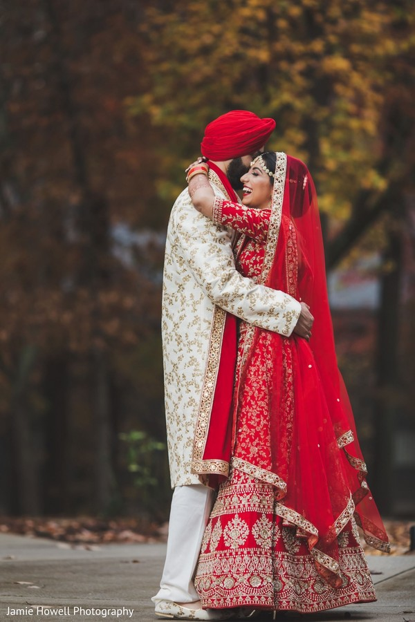 Indian couple embracing on their wedding attires