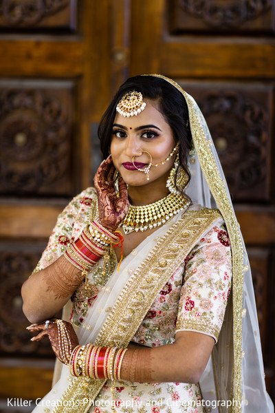 Maharani showing her makeup and jewels.