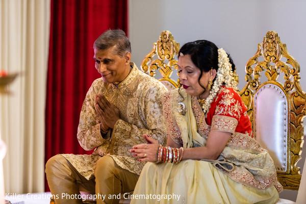 Indian relatives praying during hindu wedding.