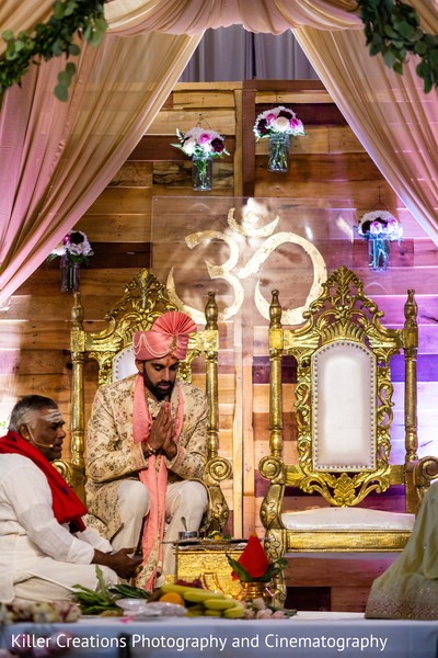 Indian groom praying in the wedding altar.