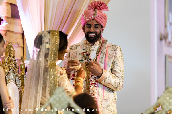 Indian groom holding a necklace for his Maharani.