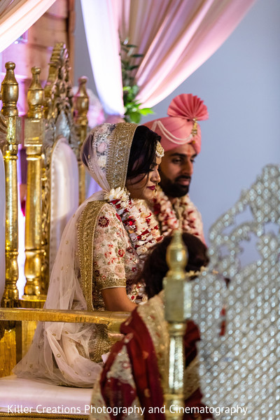 Indian couple sitting during their hindu wedding.