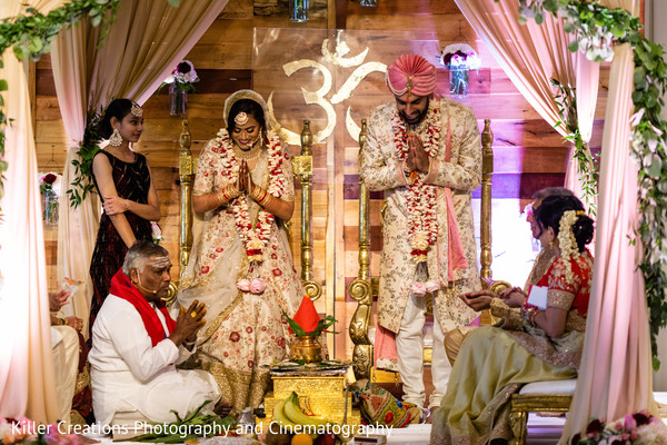 Indian couple praying during their ceremony.