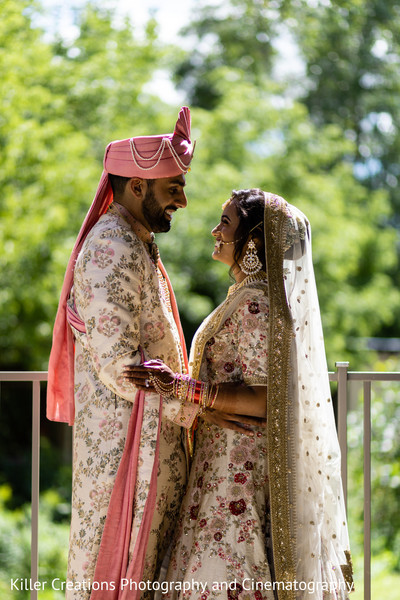 Indian couple smiling during photo shoot.