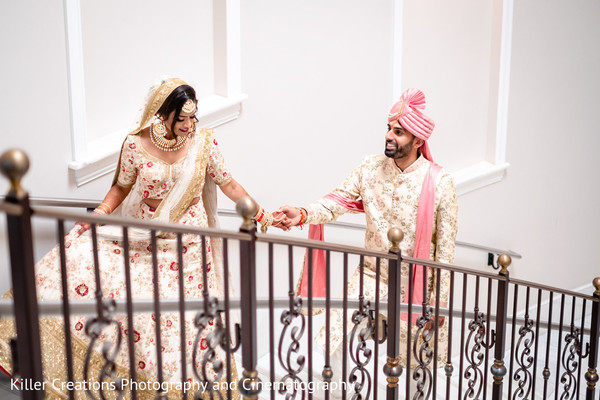 Indian couple during photo shoot on the stairs.