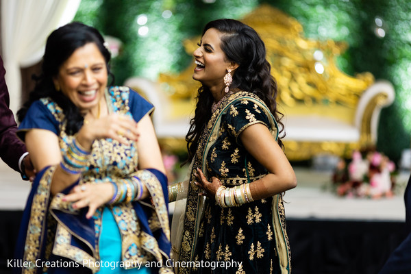 Indian bride laughing with relatives during reception.