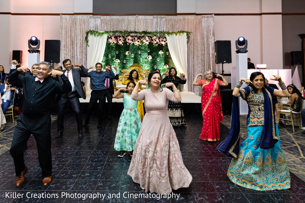 Indian relatives performing during the sangeet.