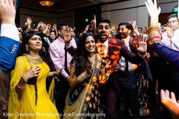 Indian couple enjoying their reception.