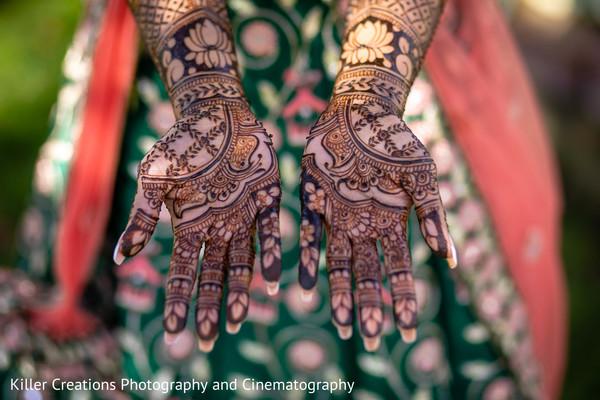 Indian bride showing er mehndi art.