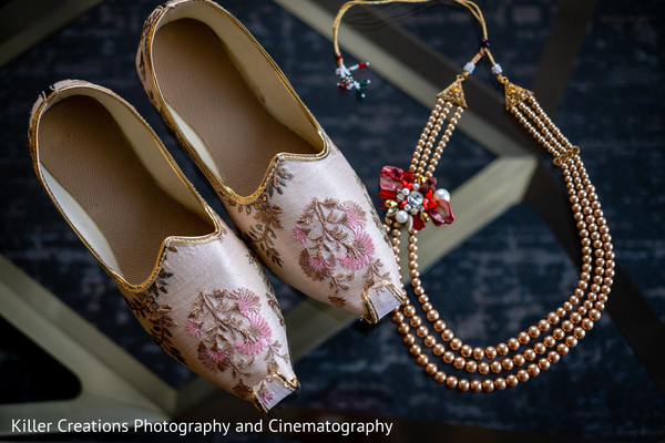 Shoes and necklace worn by Indian groom.