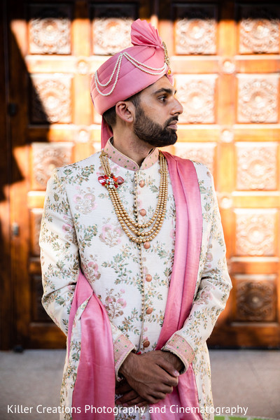 Indian groom posing for picture.