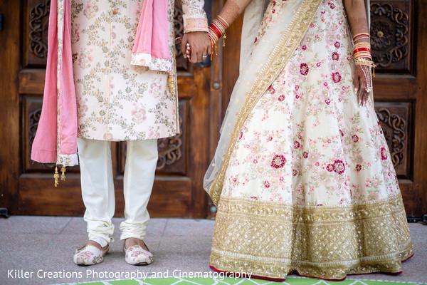 Maharani and Raja holding hands.