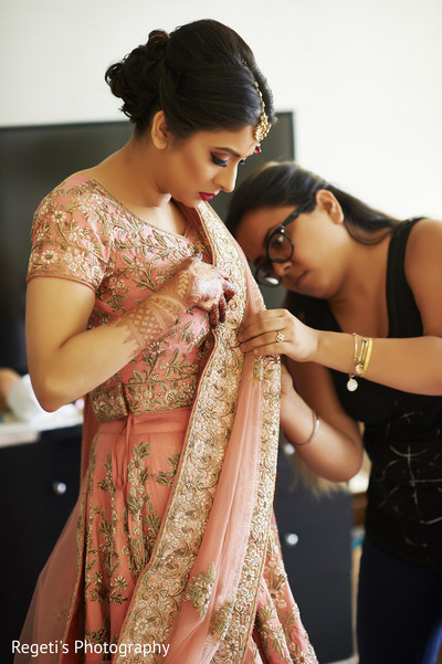 Maharani being assisted with her lengha.