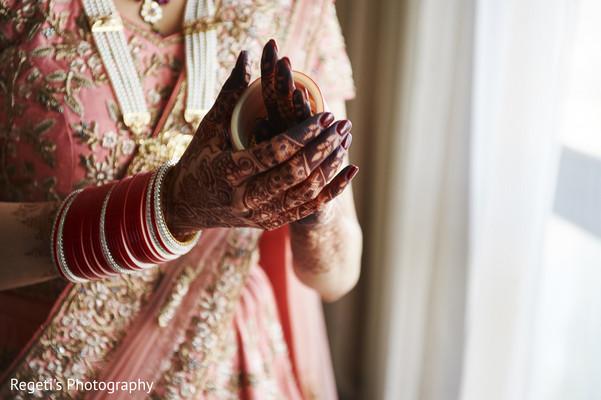 Maharani putting her bracelets on.