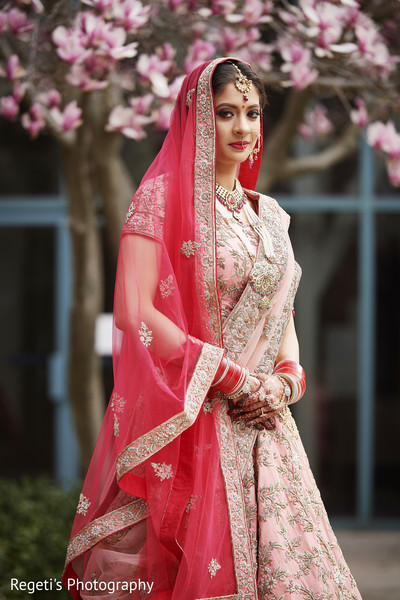 Indian bride standing for photo session.