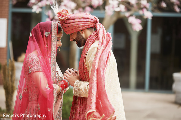 Indian couple holding hands during photo session.