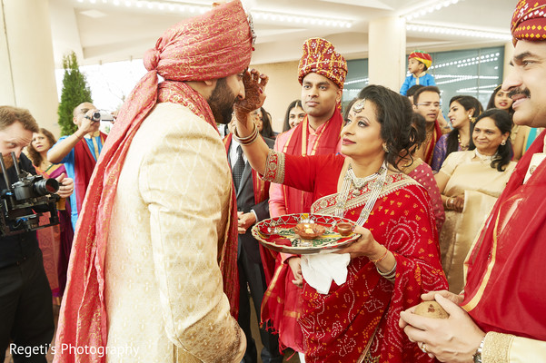 Indian groom being received by maharani's relatives.