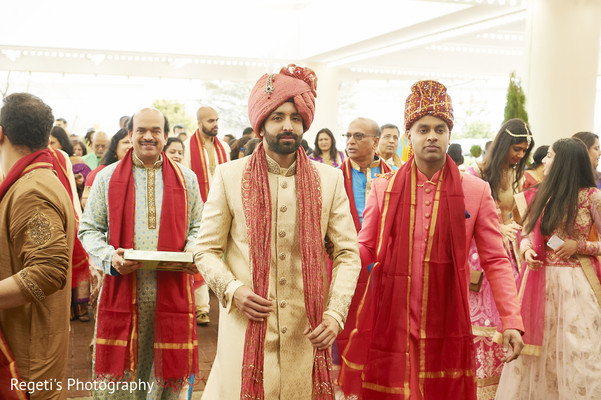 Indian groom looking at the camera during his Baraat.