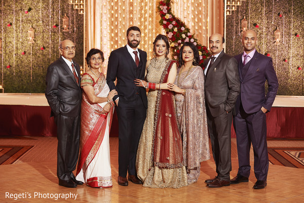 Indian couple with their relatives photo.
