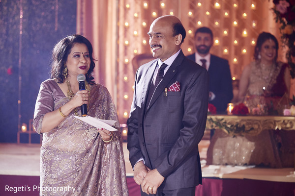 Indian relatives giving a speech for the married couple.