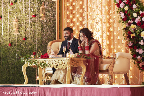 Indian couple being amused during their reception.