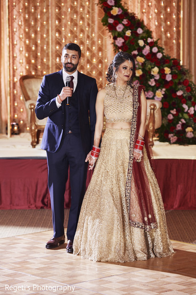 Indian groom and his Maharani giving the reception speech.