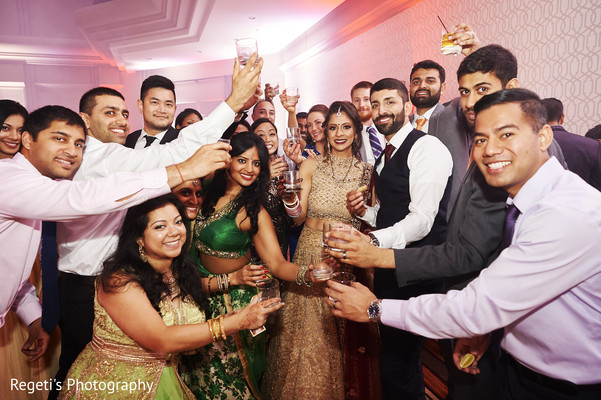 Indian couple making a toast with the guests.